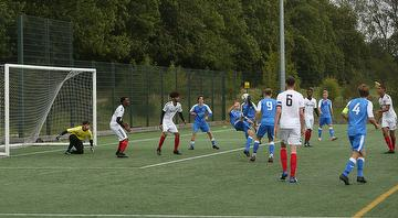 Joe Tyrie's overhead kick finds the net for the Academy side